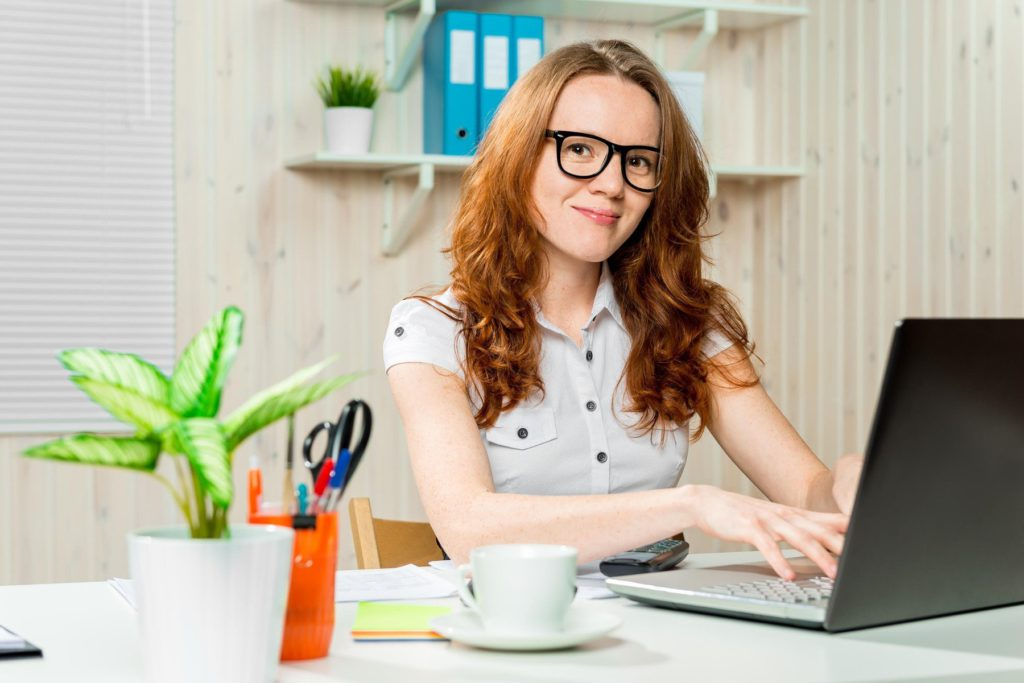 young successful accountant working in the office, Image: 308808540, License: Royalty-free, Restrictions: , Model Release: yes, Credit line: Profimedia, Alamy